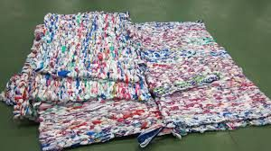 Milk Bag Weaving Mats at Holy Name!
